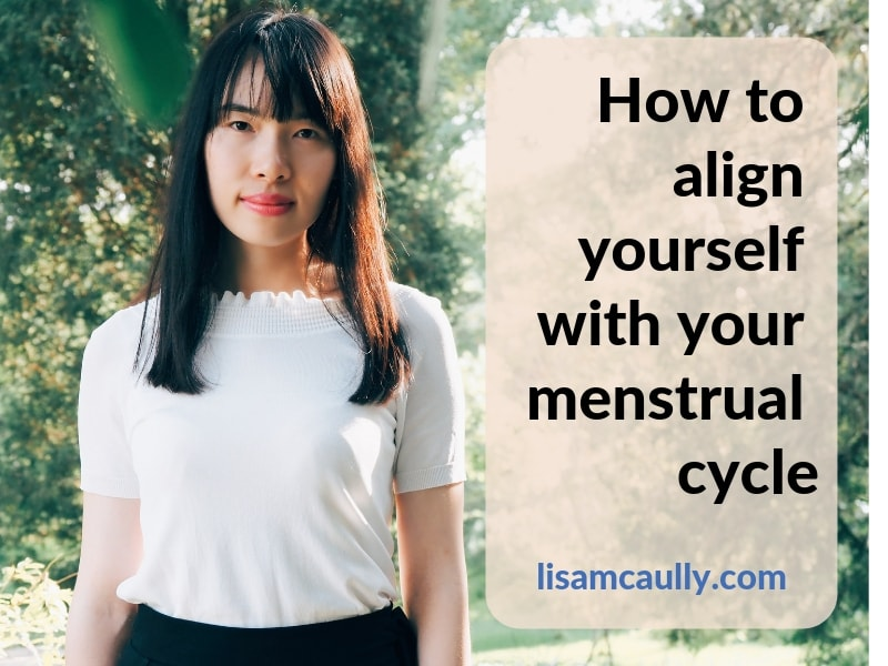 "A woman standing in front of trees. Text overlay caption says - ""How to align yourself with your menstrual cycle"""
